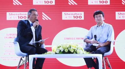 "Shane Tedjarati with Appotronics' Li Yi at the ""Shenzhen 100"" innovation conference"